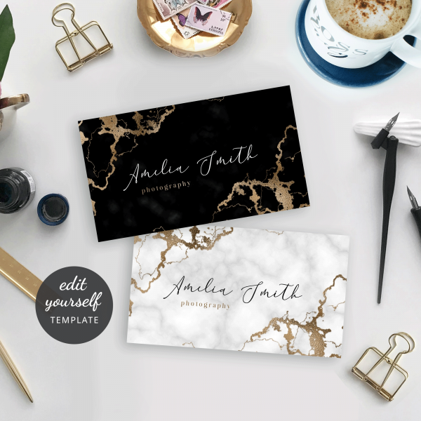 business card size template with a marble background and faux gold effects
